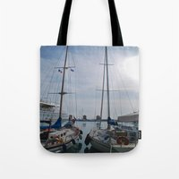 sailboat Tote Bags featuring Sailboat by M. Gold Photography