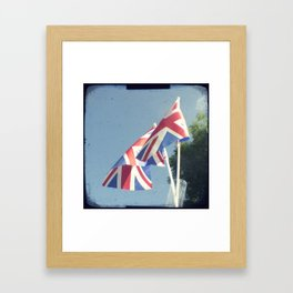 Flags - Union Jacks against a blue sky Framed Art Print