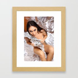 Cute nude girl posing naked on silver background. Framed Art Print