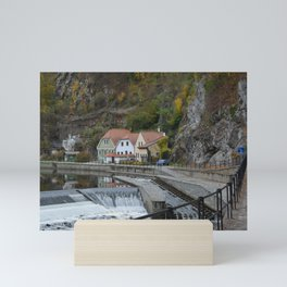 Colorful houses near a river Mini Art Print