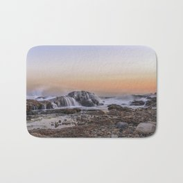 Waves on the rocks at the Backshore Bath Mat