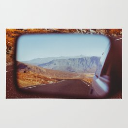 Road Tripping in Scandinavia - Road in Jotunheimen NP Through Rear Mirror Rug
