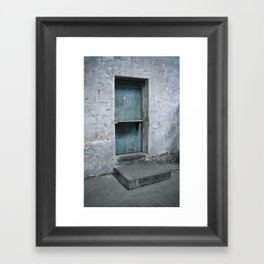 What's behind the old blue door? Framed Art Print