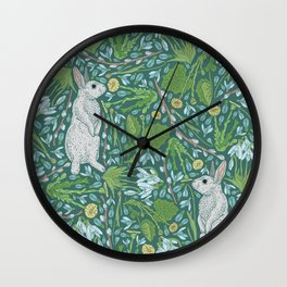 Grey hares with coltsfoots and snowdrops on green background Wall Clock