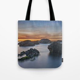 Peaceful sunset by the sea Tote Bag
