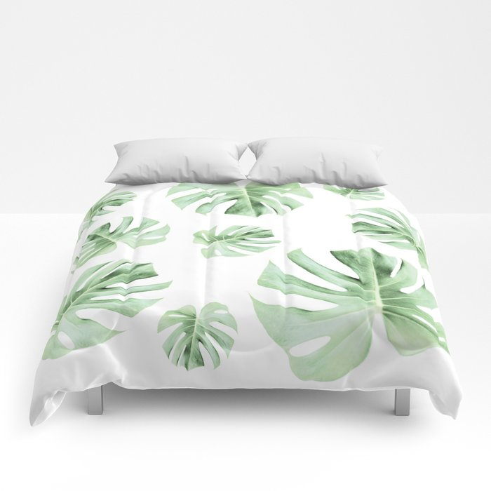 Tropical green leaves on white Comforters