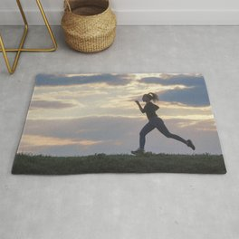 Running woman morning workout. Female Runner. Jogging during sunrise. Workout in a Park. Sporty Rug
