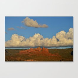 red rocks and a big cloud Canvas Print