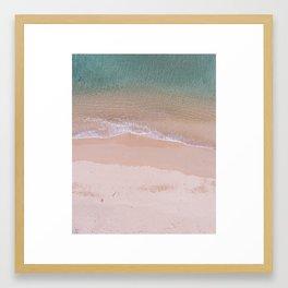 Waves on a deserted beach Framed Art Print