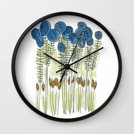 Tall skinny blue flowers with cattails Wall Clock