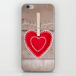 Clothesline with Valentine's Day heart decoration on a rustic background iPhone Skin