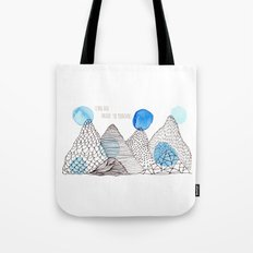 Flying high through the mountains Tote Bag