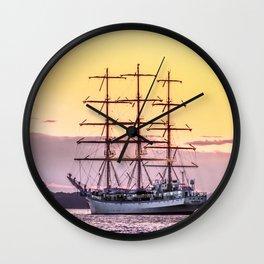 Frigate at sunset Wall Clock