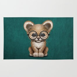 Cute Baby Lion Cub Wearing Glasses on Blue Rug
