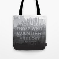 "tolkien Tote Bags featuring ""Not all those who wander are lost"" -- J. R. R. Tolkien quote poster by asiawilliams"