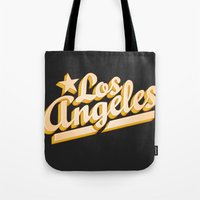 los angeles Tote Bags featuring Los Angeles by GetSolidGold