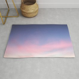 Blue evening sky with pink clouds. Photography Rug