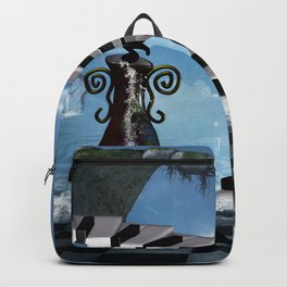 Piano on the beach with clef Backpack