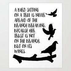 A bird sitting on a tree Art Print