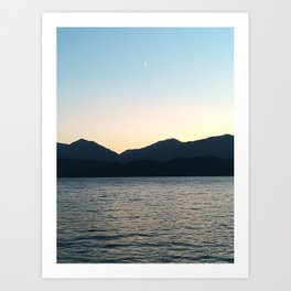 Sunset and Crescent Moon over the Water Art Print
