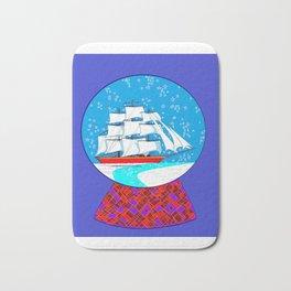 A Nautical Snow Globe with a Clipper Ship Bath Mat
