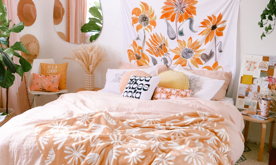 bedroom with sunflower tapestry and floral throw blanket