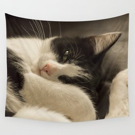 Cute sleepy black and white cat Wall Tapestry