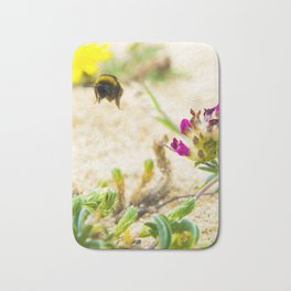 the flight of bumble bee on the bunes Bath Mat