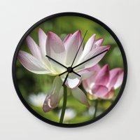 lotus flower Wall Clocks featuring Lotus by Catherine Stuckrath