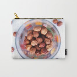 Purified hazelnut in a transparent glass with colored patterns, top view Carry-All Pouch