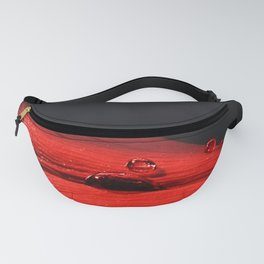 A drop of blood on a red leaf Fanny Pack