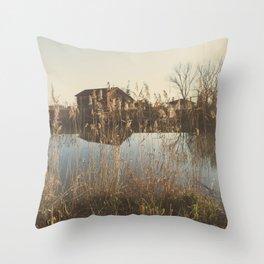 A cottage along a river Throw Pillow