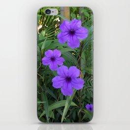 Purple flowers among green iPhone Skin
