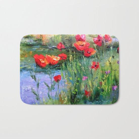 Poppies in a field near a pond Bath Mat
