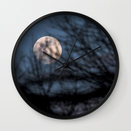 Full worm moon though the branches Wall Clock