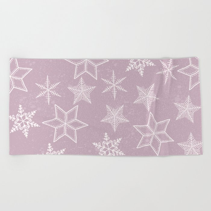 Snowflakes on pink background Beach Towel