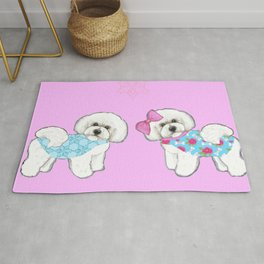 Bichon Frise Dogs in love- wearing pink and blue coats Rug