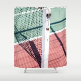 A FOCUSED SHOT OF A POST ON ONE SIDE OF A TENNIS NET. Shower Curtain