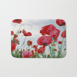 Field of Poppies Against Grey Sky Bath Mat