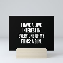 I have a love interest in every one of my films a gun Mini Art Print