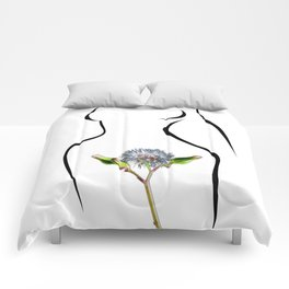 The woman and flower Comforters