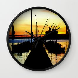 Light shines over the Harbour Wall Clock