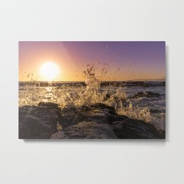 Magical sunset and waves breaking over rocky beach Metal Print