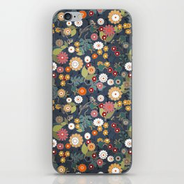 Colorful flowers on a denim background. iPhone Skin