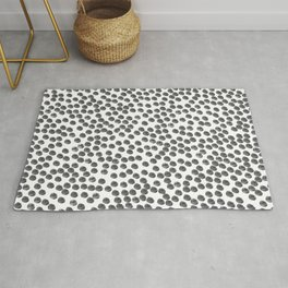 Dots that are the color black Rug