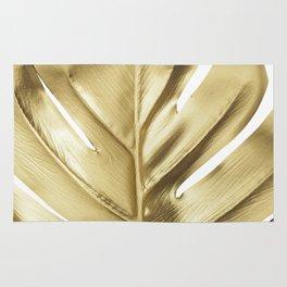 Gold monstera leaf Rug