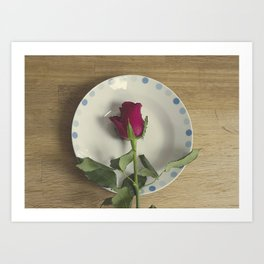 Red rose on a plate Art Print