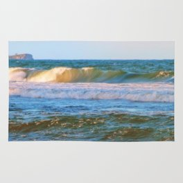 Rolling wave and headland Rug