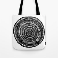 tree rings Tote Bags featuring Tree Rings by Irene Leon