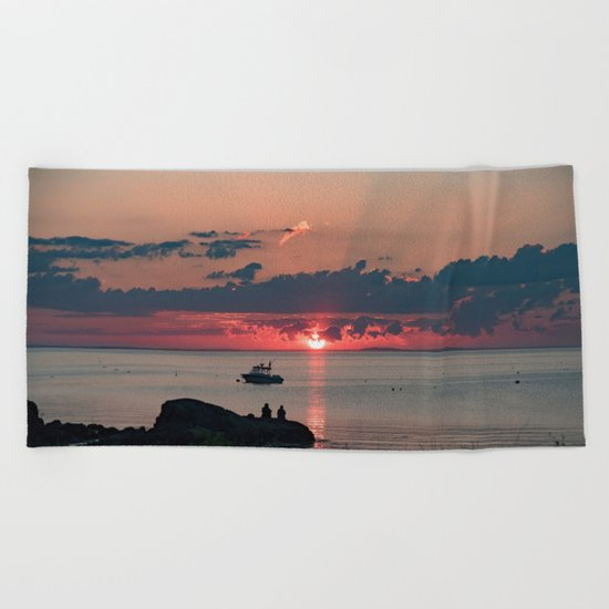Sunset on the rocks Beach Towel